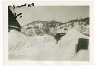 My grandma shoveling snow in the Black Hills of South Dakota, winter, 1930's