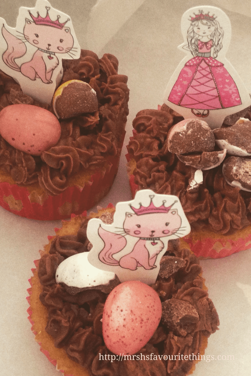 Three vanilla cupcakes with chocolcate icing and chocolate eggs and princess and her kitten toppers_My Captured Moment_a special afternoon tea party_Mrs H's favourite things
