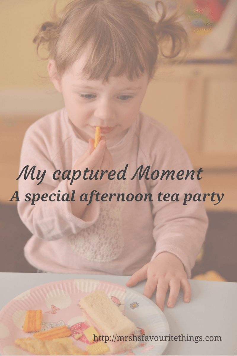 A little girl with bunches eating tea from a princess party plate with the post title My Captured Moment_a special afternoon tea party_Mrs H's favourite things