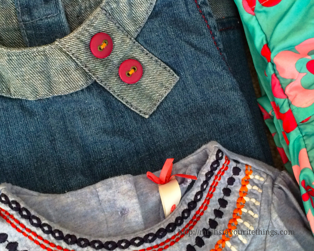 3 items of baby clothing _ a denim dress, a light blue smock top and a green and flowery waterproof coat_ From a Mother to Another - a JoJo Maman Bébé Charity Campaign _ Mrs H's favourite things