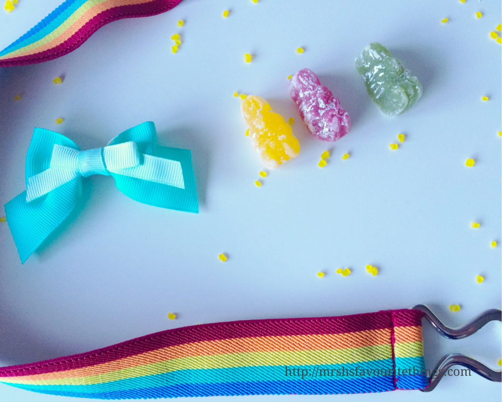 A photograph of a few of my five products each purchased for under £5.00, including some Jelly Bunnies, a green bow hair clip and a rainbow belt - Five under £5 - March_ Mrs H's favourite things