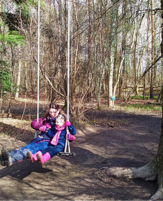 A photograph of a mother and her young daughter on a swing in the middle of a wood - A perfect Mother's Day - Mrs H's favourite things