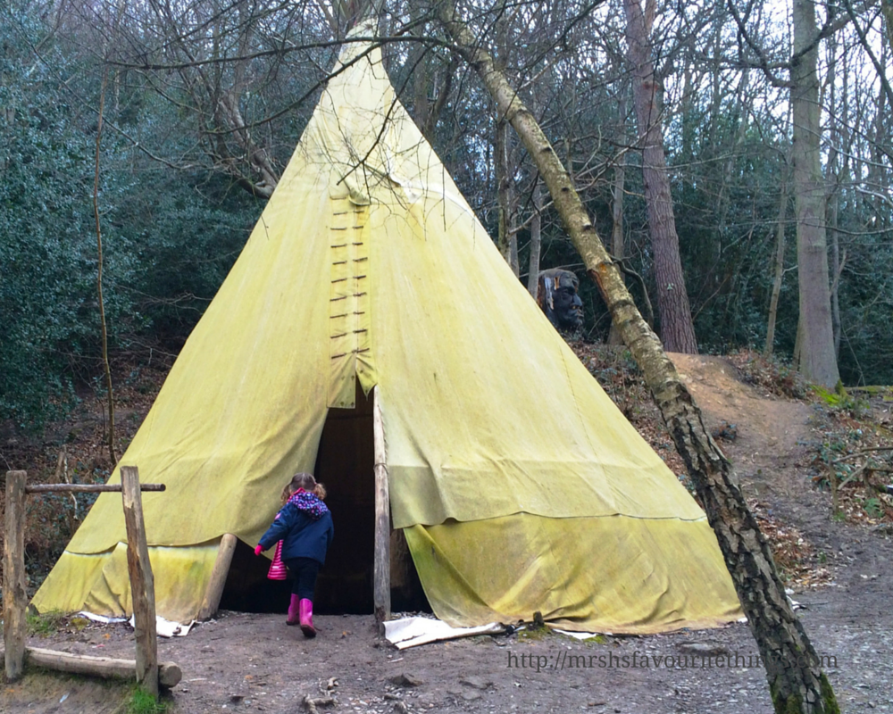 A photograph of a little girl running into a teepee in the middle of the Enchanted Forest at Groombridge Place _ A perfect Mother's Day _ Mrs H's favourite things