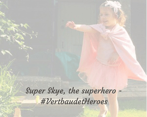"A little girl dressed in pink with bunches and a hairband stands in a garden and smiles_including the blog post title ""Super Skye, the superhero - #Vertbaudetheroes"" - Mrs H's favourite things"