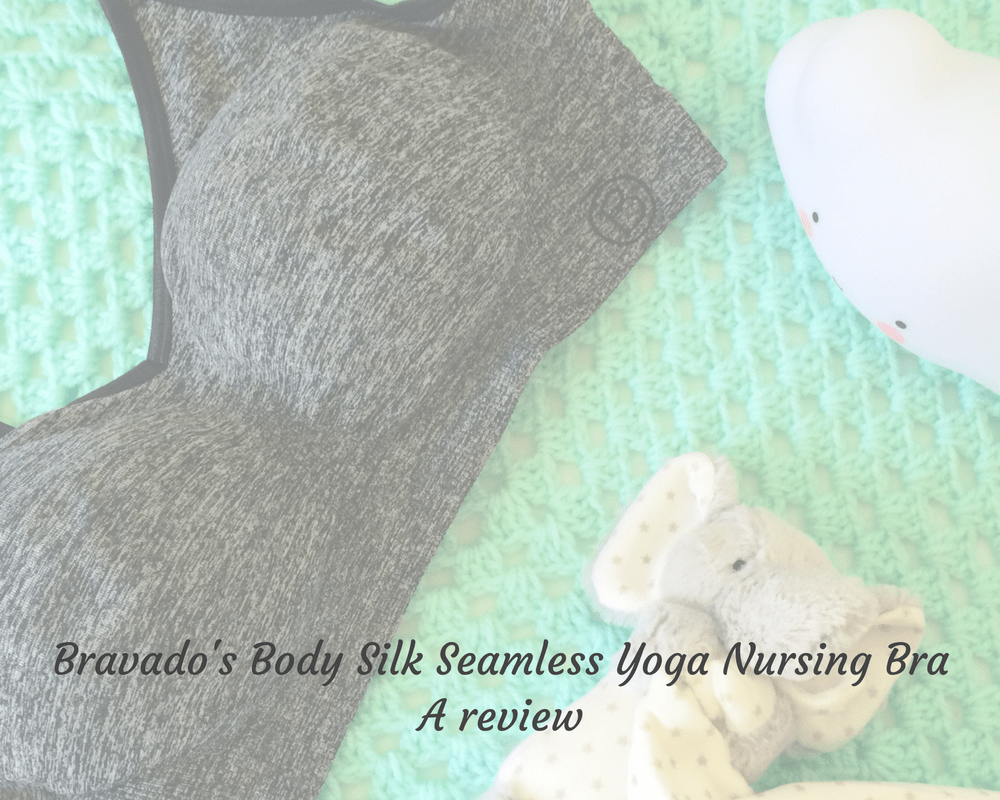 "A faded photograph of the Bravado Body Silk Seamless Yoga Nursing Bra in Charcoal Heather - lying on a green blanket - next to a small cloud nightlight and an elephant soft toy soother - includes the title ""Bravado's body silk seamless yoga nursing bra - a review"" - Mrs H's favourite things"