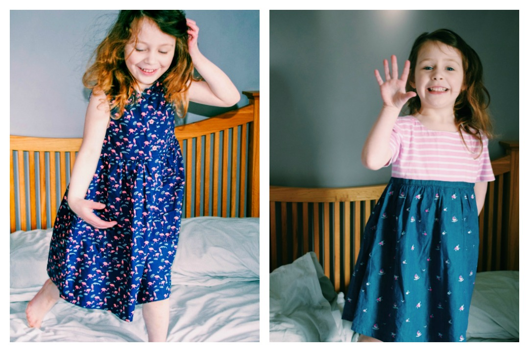 A photograph of a gorgeous three year old girl modelling some Beautiful Summer Clothes from JoJo Maman Bebe including the Girls' Flamingo Shirt Dress and Girls' Embroidered Chambray T-Shirt Dress - Beautiful Summer Clothes from JoJo Maman Bébé - Mrs H's favourite things