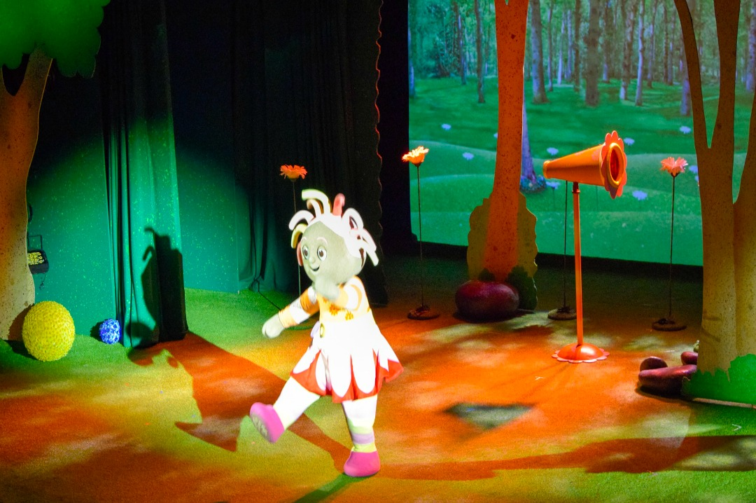 "A photograph of Upsy Daisy dancing and singing into her megaphone at In the Night Garden Live - a photograph from the post ""In the Night Garden Live - a review"" - Mrs H's favourite things"