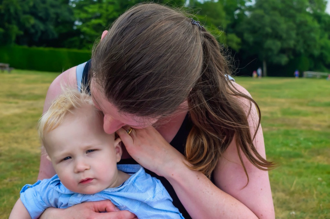 A photograph of a mother nuzzling her head into the top of her baby boy's head - on the occasion of her little boy's first birthday - Baby of Mine - Now You are One - Mrs H's favourite things