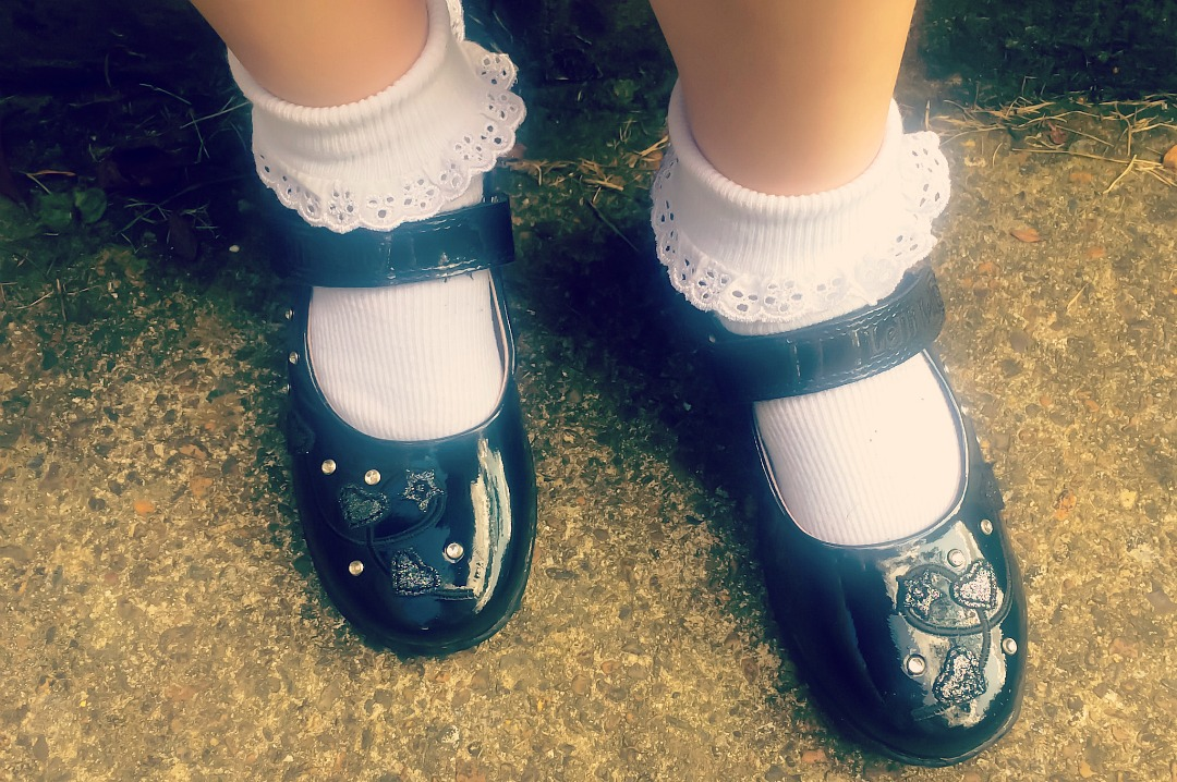 A photograph of a little girl's first ever pair of school shoes which are from the website Jake Shoes and a pair of black patent Lelli Kelly School Shoes - The First pair of school shoes with Jake Shoes - Mrs H's favourite things