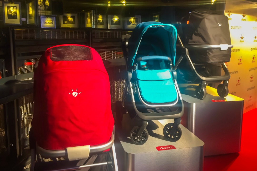 A photograph of three of the Diono Quantum travel systems that were at the launch of the Diono Quantum - each Quantum is in a different configuration of the travel system and one is red, one is black and one is teal - #AdventureReady with the Diono Quantum travel system - the launch and first impressions - Mrs H's favourite things