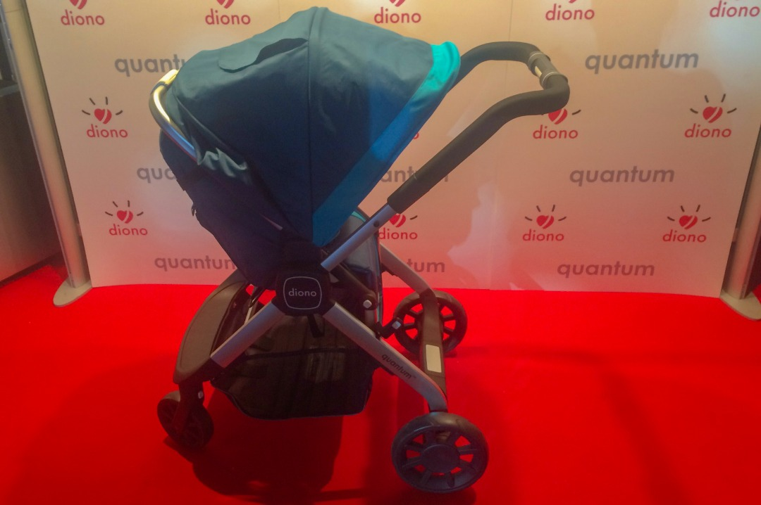 A photograph of the teal coloured Diono Quantum travel system on the red carpet at the exclusive press launch of the Diono Quantum travel system - #AdventureReady with the Diono Quantum travel system - the launch and first impressions - Mrs H's favourite things