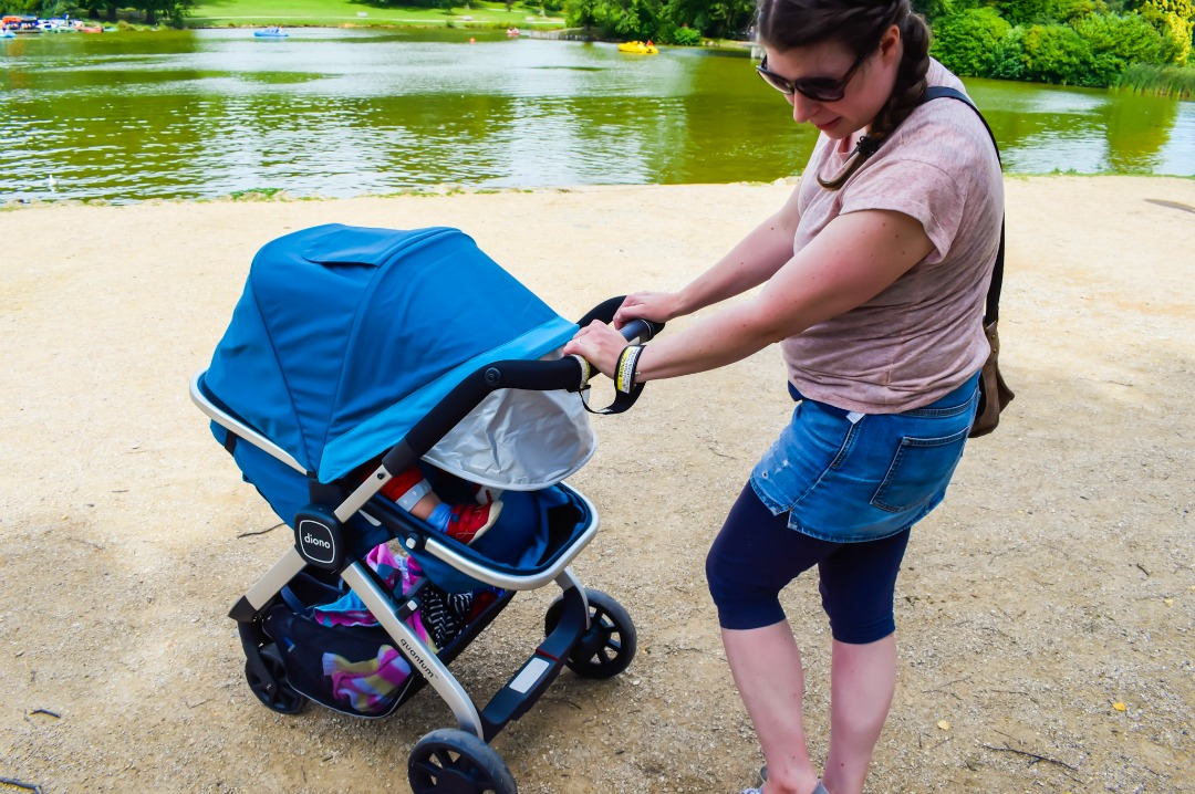 A mother standing in front of her sleeping baby in a teal Diono Quantum travel system and #adventureready in a beautiful park - #AdventureReady with the Diono Quantum travel system - the launch and first impressions - Mrs H's favourite things
