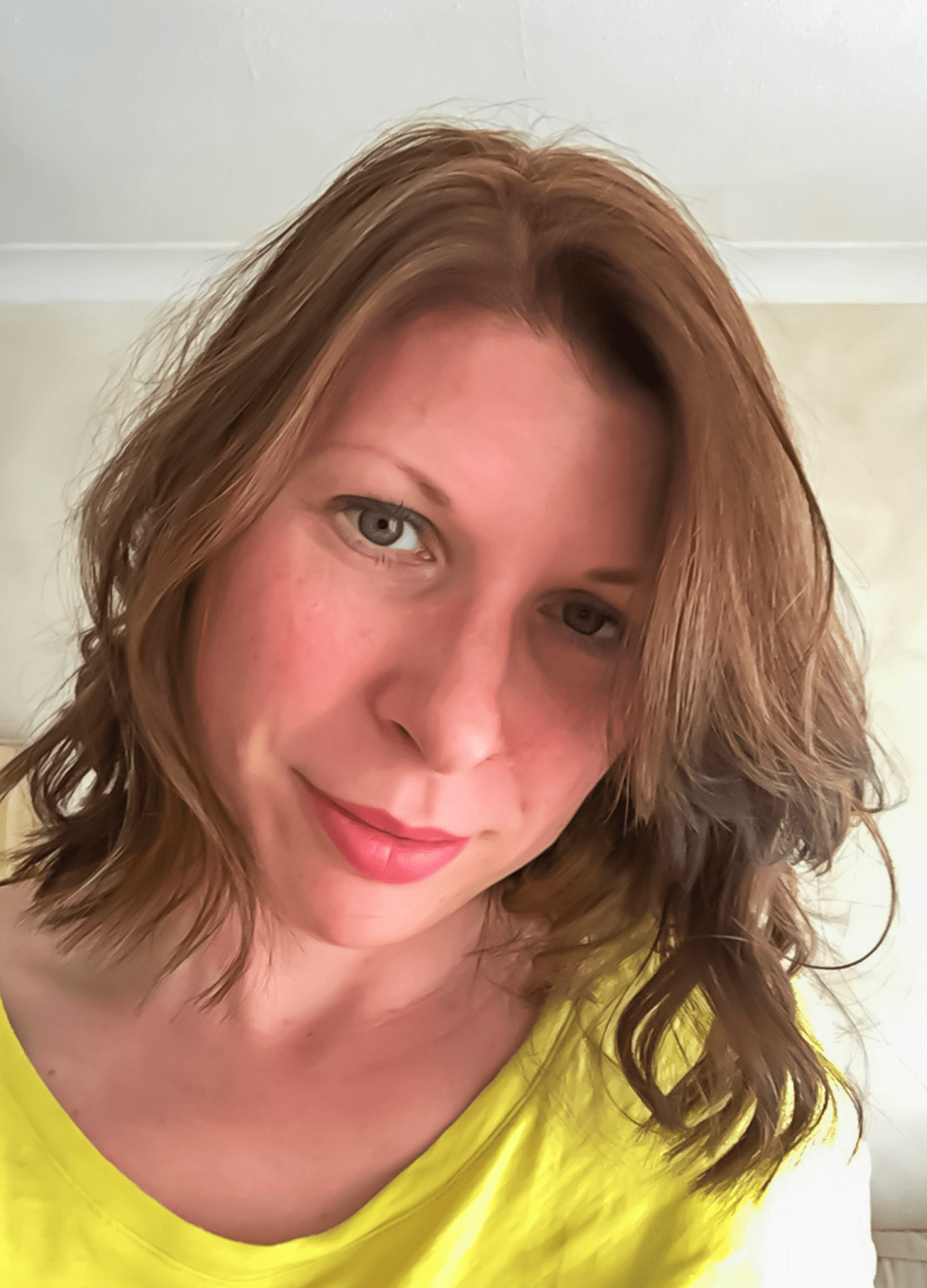 A photograph of a 39 year old woman looking into the camera with her head tilted to one side and a slight smirk on her face and wearing a yellow t-shirt - 39 Life Lessons for 39 Years - Mrs H's favourite things