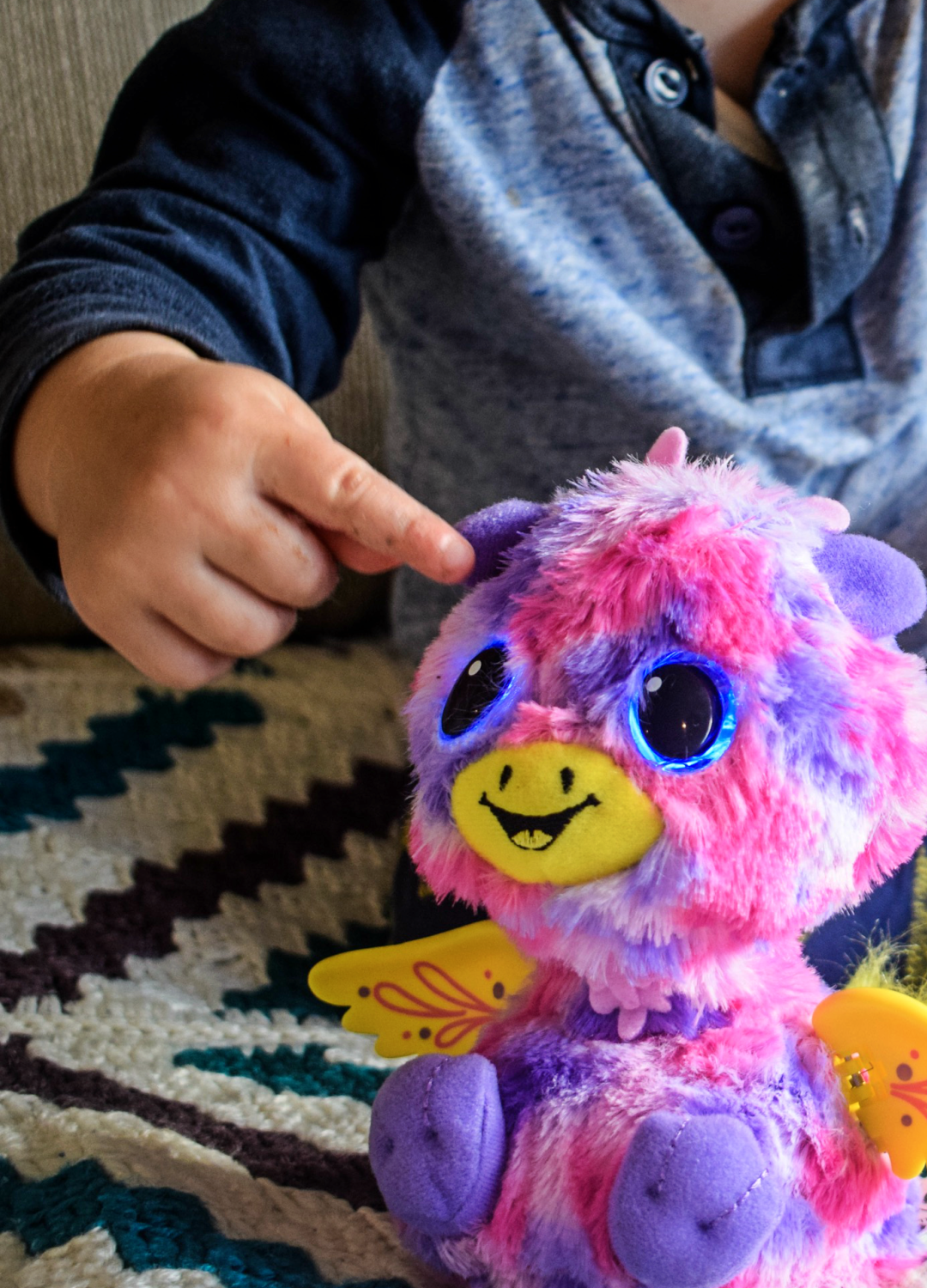 A photograph of one of the Giraven twins from the Hatchimals Surprise eggs being played with by a small boy - Reviewing the Brand New Hatchimals: Hatchimals Surprise - Mrs H's favourite things