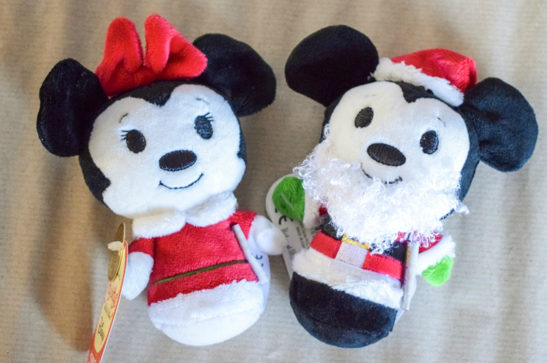 A photograph of the Christmas collector's edition of Hallmark and Disney Itty Bittys Minnie Claus and Santa Mickey, these soft toys are included in our Christmas Eve Box - Our Christmas Eve Box - What's inside? - Mrs H's favourite things