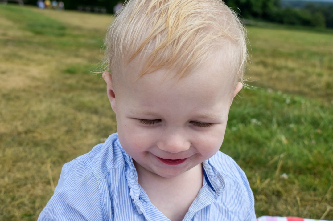 A photograph of a one year old baby boy smiling - 50 MORE things that make me happy - Mrs H's favourite things