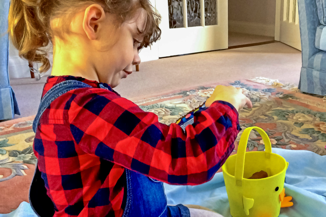 A photograph of a little girl having just done on an Easter egg hunt - Fun Things To Do In The Easter Break - Mrs H's favourite things