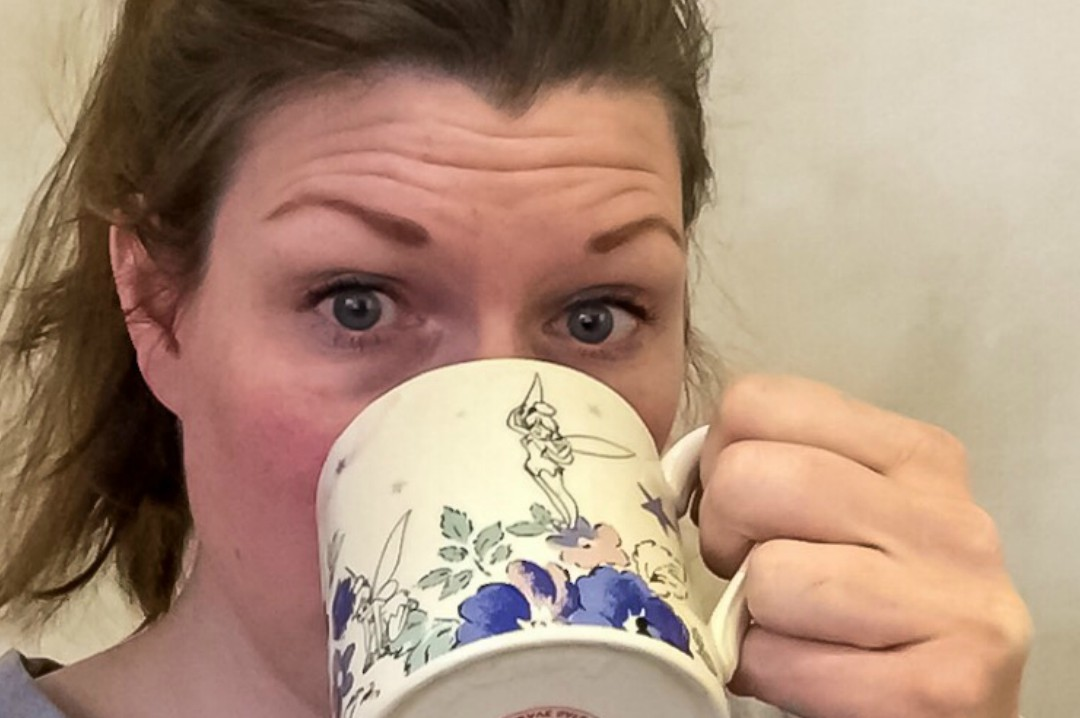 A photograph of a brunette woman drinking a cup of tea from a Cath Kidston mug - The Person Behind Mrs H's favourite things - A Random Q & A - Mrs H's favourite things
