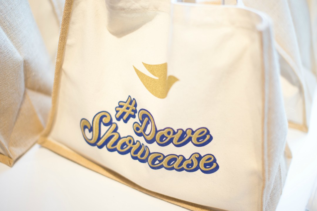 A photograph of a goodie bag with the logo #Dove Showcase from a Baby Dove event about skin care when taking babies swimming - Baby Swimming Skin Care with Baby Dove - Mrs H's favourite things