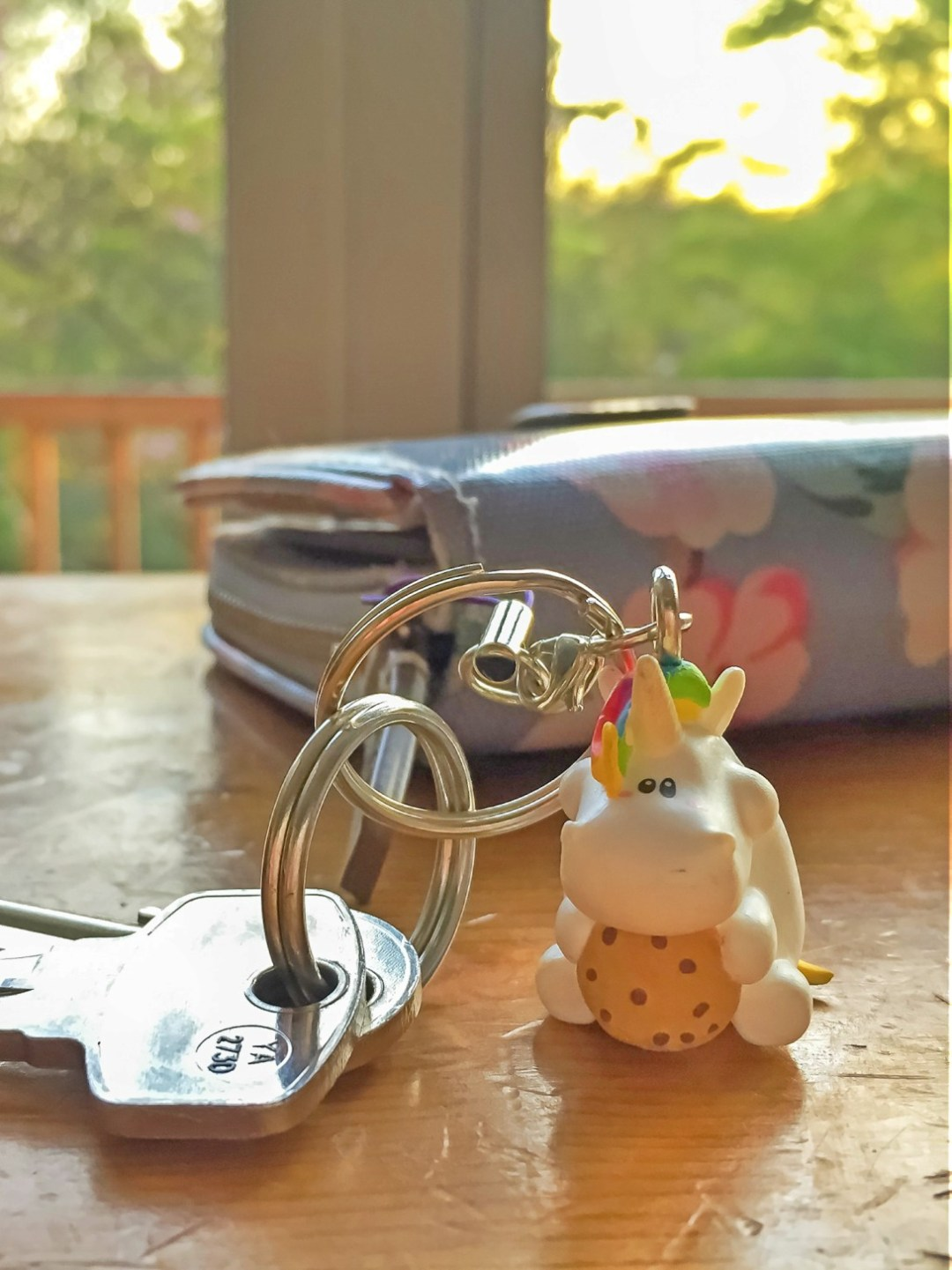 A photograph of a Bullyland Chubby Unicorn Key Chain with some keys attached and next to a ladies' purse - Bullyland Chubby Unicorn Figurines - A Review - Mrs H'sfavourite thins