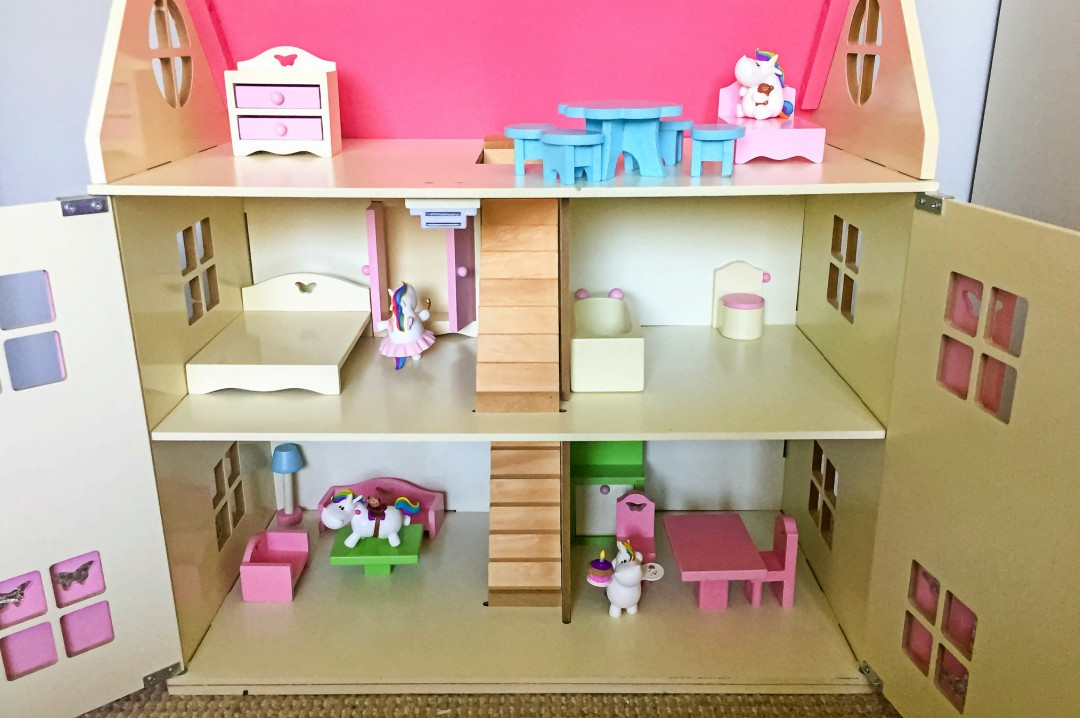 A photograph of four Bullyland Chubby Unicorns who have begun to live in a little girl's dolls house - Bullyland Chubby Unicorn Figurines - A Review - Mrs H's favourite things