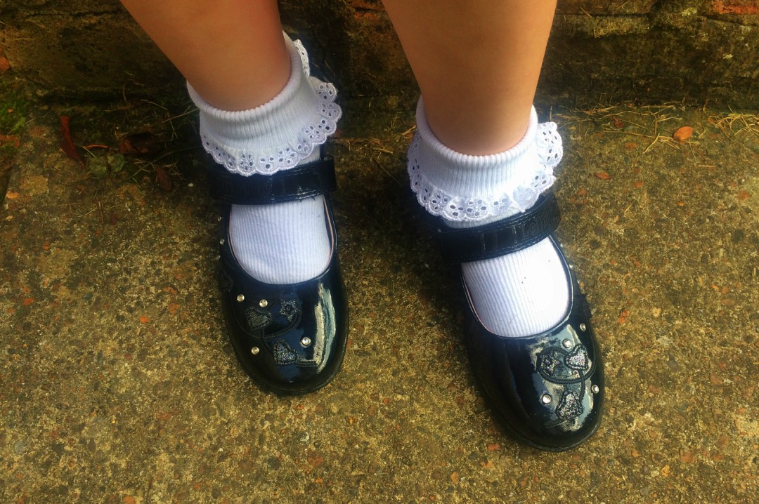 A photograph of a little girl's school shoes and school socks - How To Make The School Run Easier - Mrs H's favourite things