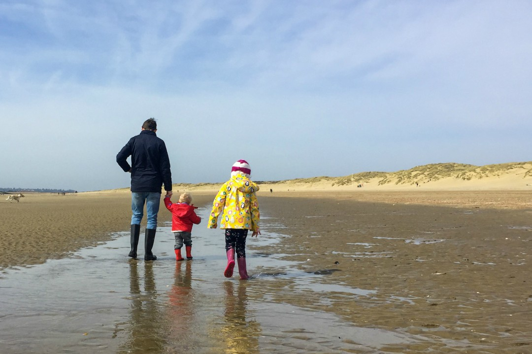 A photograph of a dad, his son and his daughter all dressed up in coats etc and paddling at Camber Sands - Our Weekend Happy - Pottering, A Beach Day & Seeing Auntie B _ Mrs H's favourite things