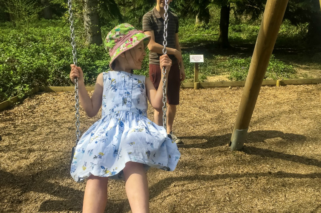 A little plays on the swings at Pepenbury Woodlands in Kent- Our Weekend Happy 13: Country Parks, Woodland Walks and a Party - Mrs H's Favourite Things