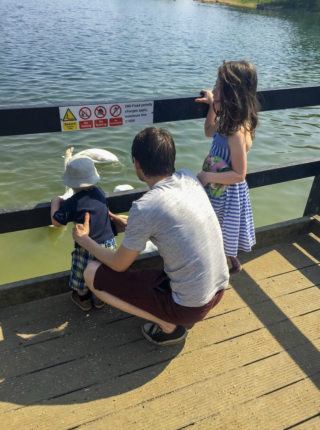 A photograph of a dad, his son and daughter looking out over a lake on a beautiful sunny day - Our Weekend Happy 13: Country Parks, Woodland Walks & Parties - Mrs H's favourite things