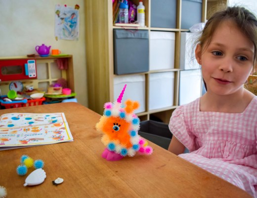A photograph of a little girl with the Bunchems princess that she has made from the Bunchems Unicorn Theme Pack - Bunchems Unicorn Theme Pack - A Review - Mrs H's favourite things