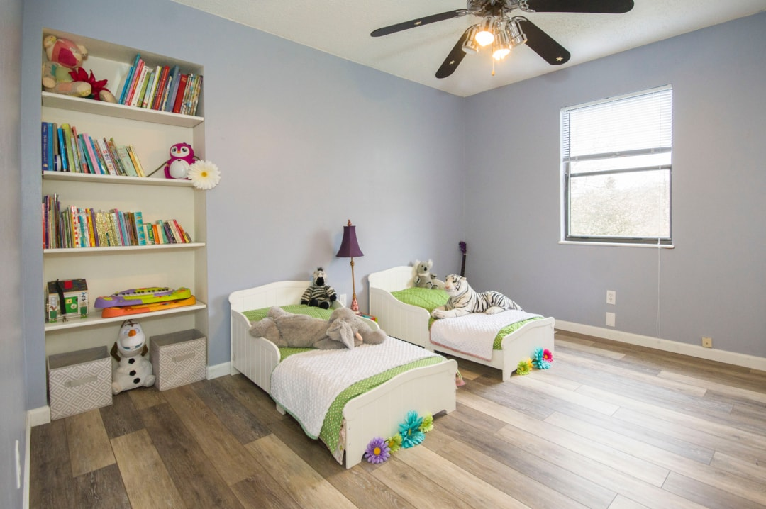 A photograph of two single beds side by side in a nicely decorated children's bedroom - Creating A Homely Vibe That Will Make The Whole Family Happy - Mrs H's favourite things