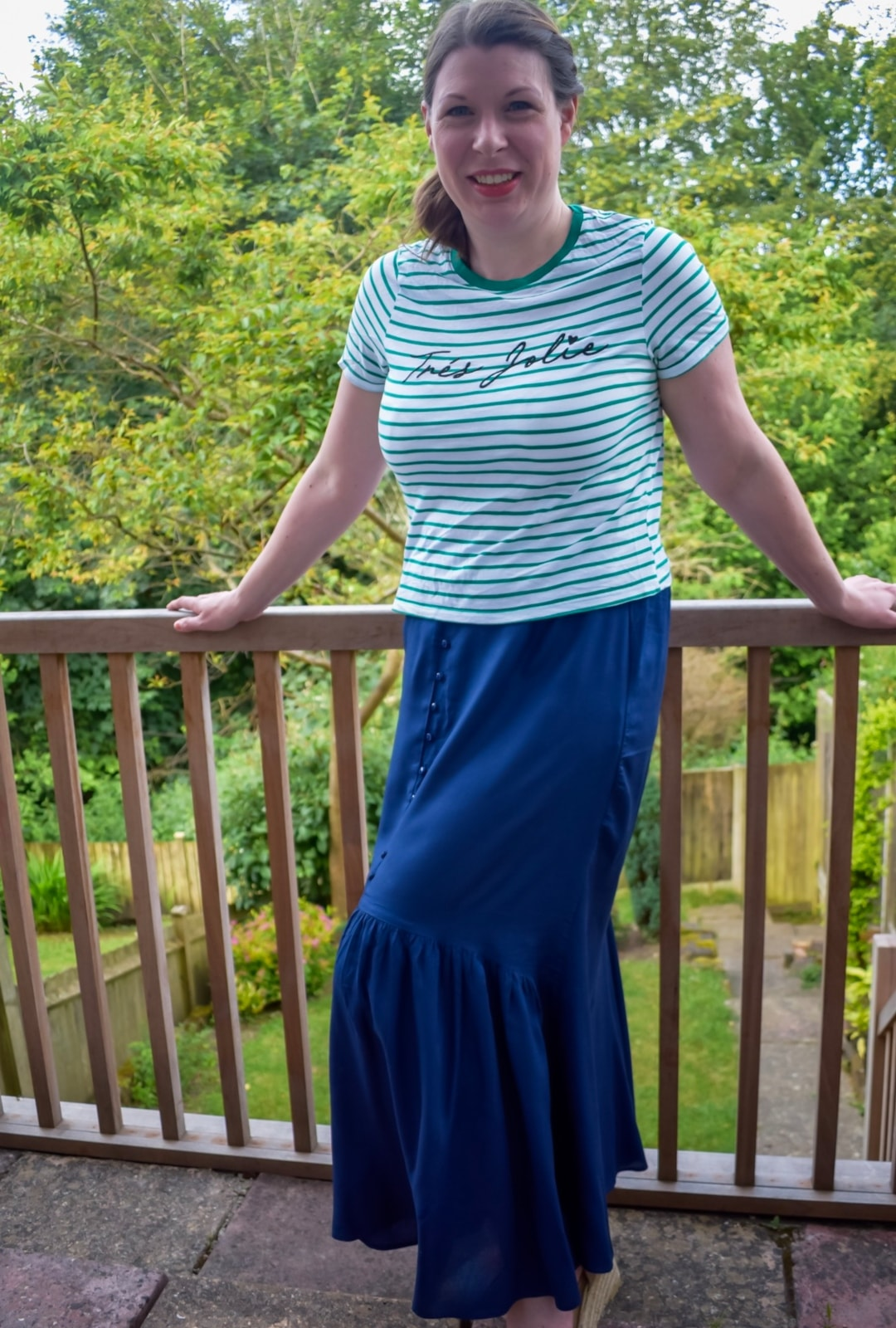 A photograph of a lady in her garden wearing a maxi skirt from Fashion World - Summer Fashion Essentials From Fashion World - Mrs H's favourite things