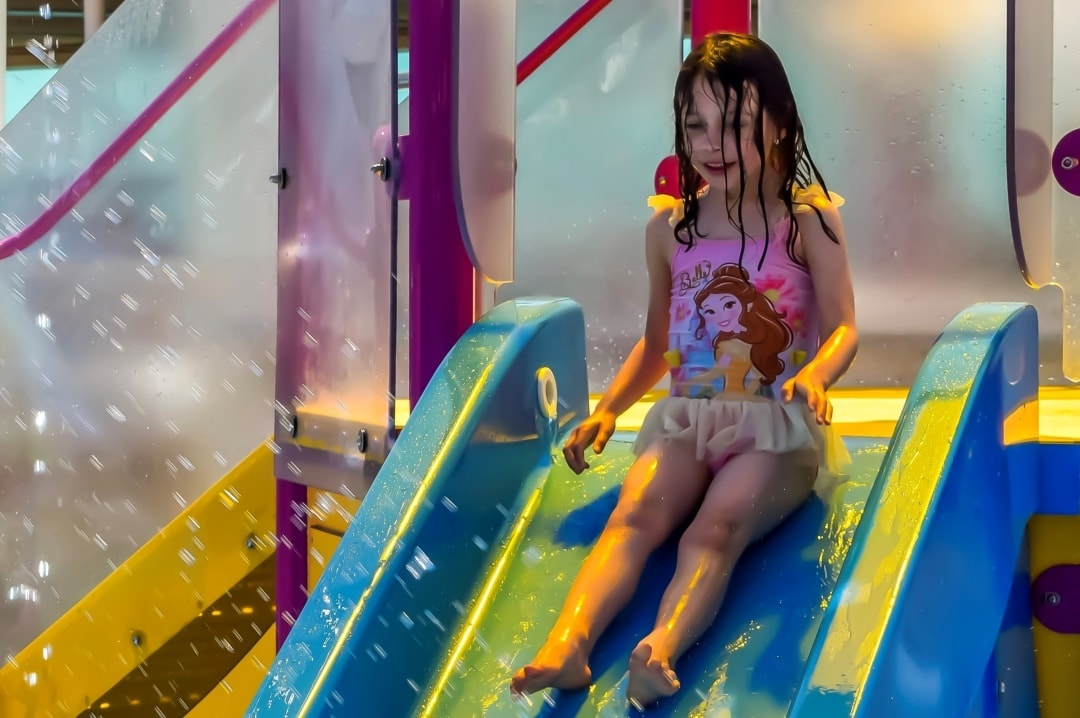 A photograph of a little girl on a slide in Splashaway Bay on the Royal Caribbean Cruise ship Independence of the Seas - 10 Reasons Why A Royal Caribbean Cruise Would Make A Perfect Family Holiday - Mrs H's favourite things