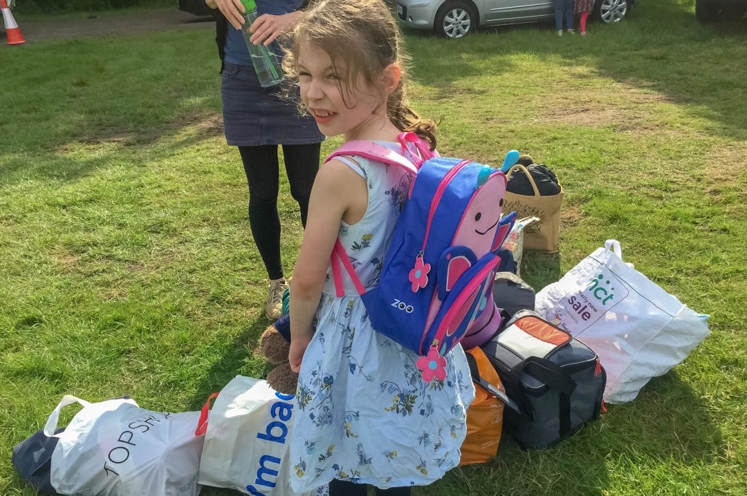 A little girl wearing a Skip Hop Zoo Little Kids Backpack at Elderflower Fields Festival - Our First Family Festival and Our Festival Essentials - Mrs h's favourite things
