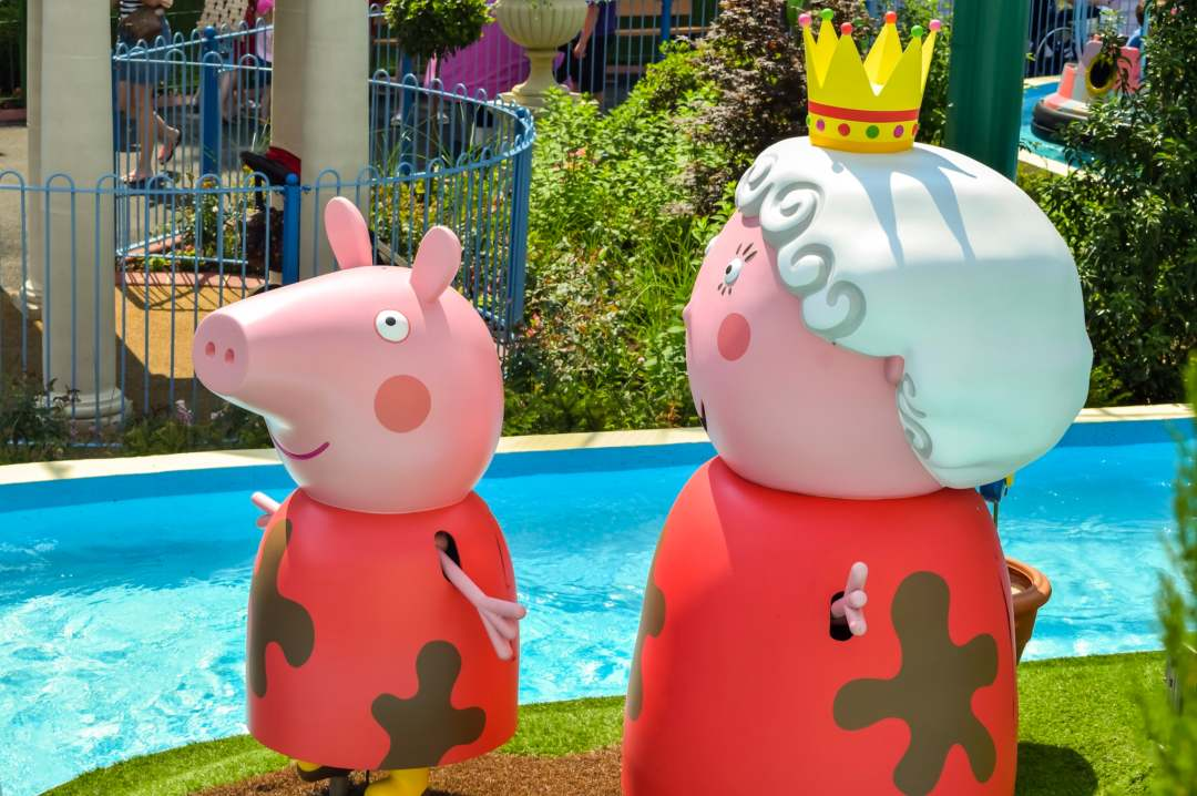 A photograph of the queen and Peppa Pig from the ride Grampy Rabbit's Sailing Club at Peppa Pig World in Paultons Park - Paultons Park and Peppa Pig World - A Review - Mrs H's favourite things