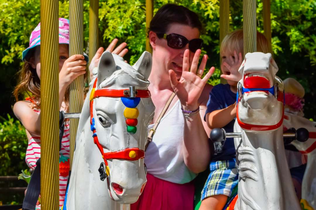 A photograph of a mother, son and daughter on the Desert Chase carousel ride at LEGOLAND Windsor Resort - A Review - Mrs H's favourite things