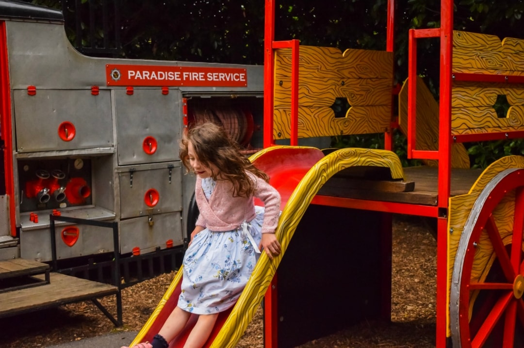 A photograph of a little girl on a slide at a play park in Paradise Wildlife Park - Paradise Wildlife Park - A Review - Mrs H's favourite things