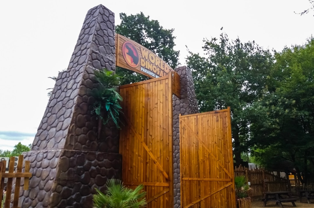 A photograph of the gates to the World of Dinosaurs at Paradise Wildlife Park - Paradise Wildlife Park - A Review - Mrs H's favourite things