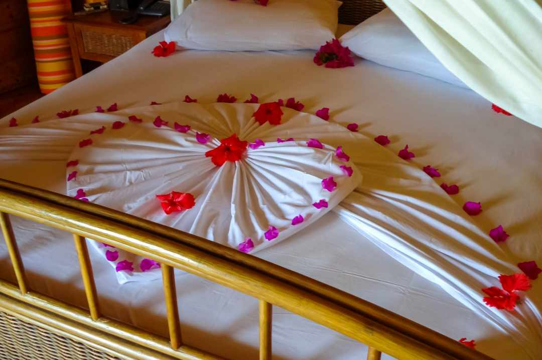 A photograph of some beautifully folded sheets in a water villa in the Maldives - My Favourite Holiday - Our Honeymoon In The Maldives - Mrs H's favourite things