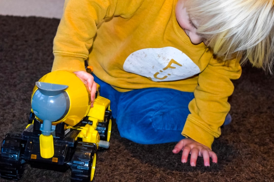 A photograph of a little boy playing with the Tonka Power Movers Cement Mixer from the Tonka Power Movers Vehicles collection - Tonka Power Movers Vehicles - A Review - Mrs H's favourite things