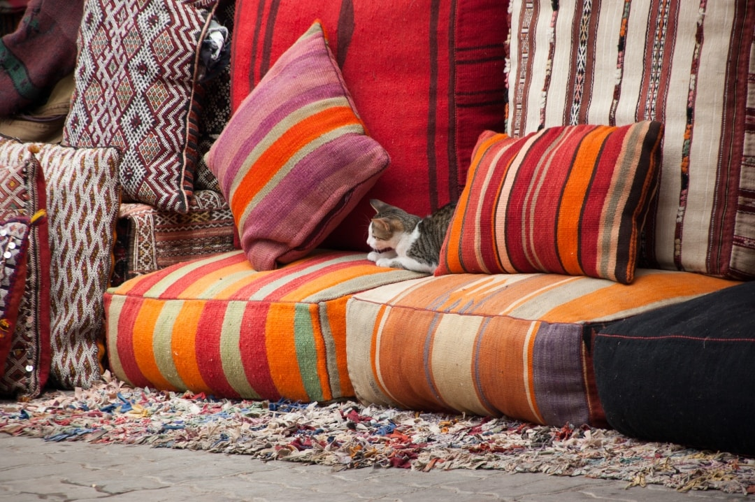 A photograph of a sofa covered in different textures of cushions - How To Bring Your Home To Life With Accessories - Mrs H's favourite things
