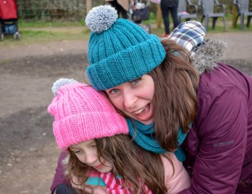 A photograph of a Mum with depression cuddling her five-year-old daughter - 7 Things Depression Has Taught Me - Mrs H's favourite things