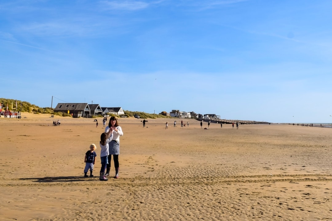 A photograph of a woman, her son and her daughte flying a kite on Camber Sands - My Top Seven of 2018 - Mrs H's favourite things