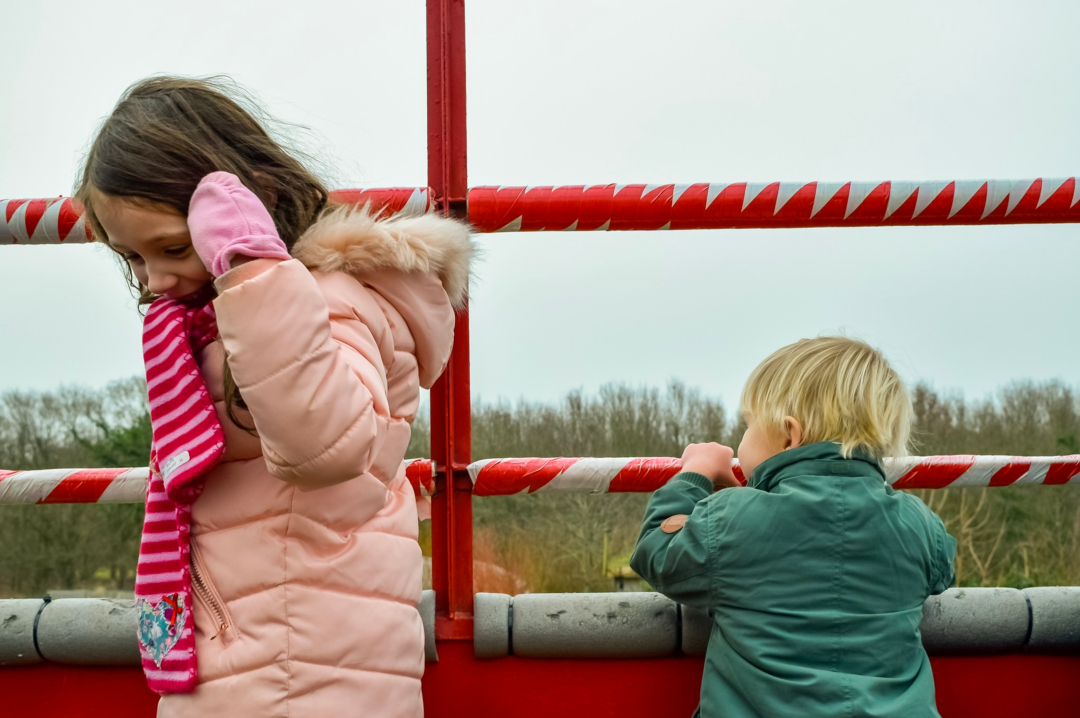 A photograph of a little girl and a little boy smiling happily on a tractor at a farm - Finding Happiness and Chasing Rainbows January 2019 - Mrs H's favourite things