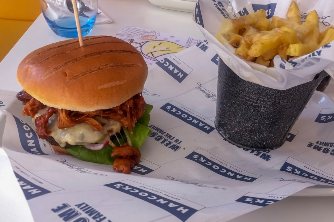 A photograph of a burger and some cheesy chips - Finding Happiness And Chasing Rainbows - February 2019 - Mrs H's favourite things