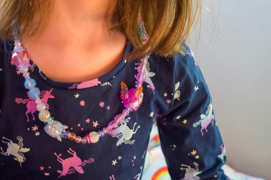 A photograph of a little girl wearing her Twisty Petz as a necklace - Twisty Petz CollectAbles From Spin Master - A Review - Mrs H's favourite things