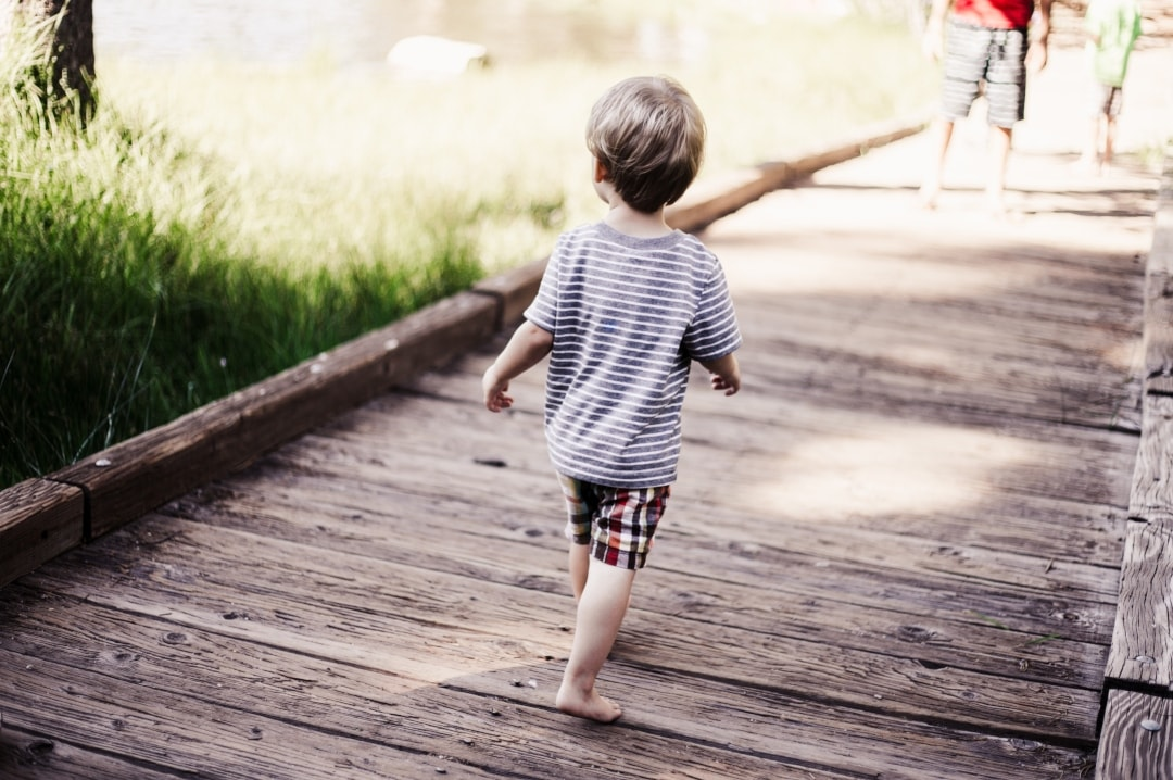 A photo of a child running on a bridge - Raising Your Child To Be Emotionally Strong - Mrs H's favourite things
