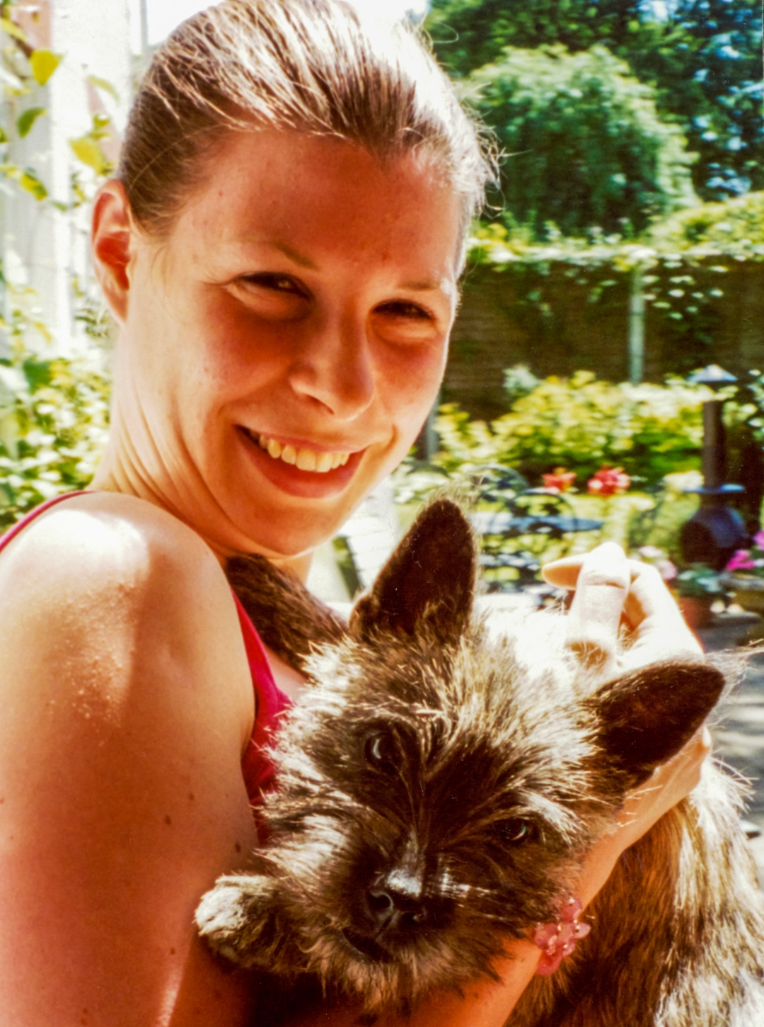 A photograph of a 23-year-old girl holding a terrier puppy in her garden - An Open Letter To My 23-Year-Old Self - Mrs H's favourite things