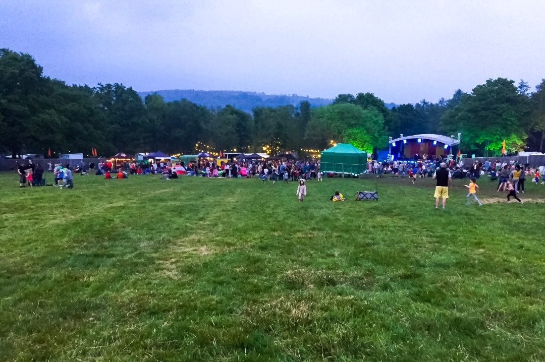 A photograph of a festival stage with festival goers dancing and having fun - Elderflower Fields - The Perfect Family Festival - Part One - Mrs H's favourite things