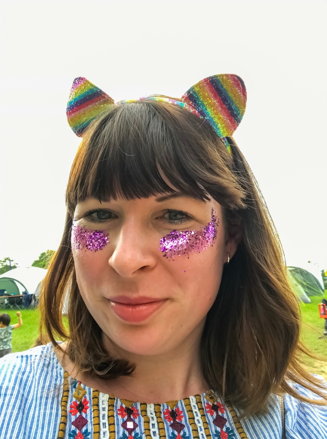 A photograph of a lady dressed up for a festival with glitter on her face at Elderflower Fields Festival - Elderflower Fields: The Perfect Family Festival - Part One - Mrs H's favourite things